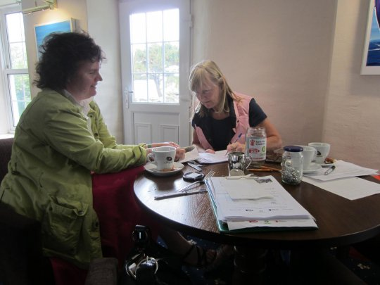 Sue and Jacky make sure the sponsor money balances.JPG