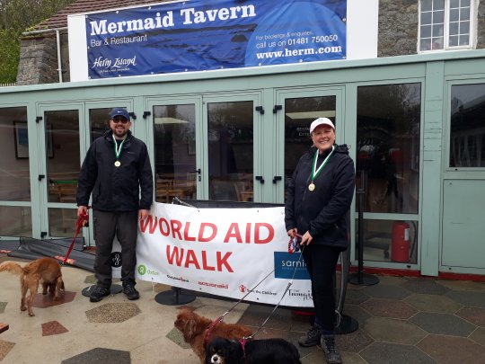 Two and four legged friends finish the Herm World Aid Walk 2017